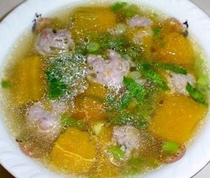 Cambodian food meatball soup with pumpkin
